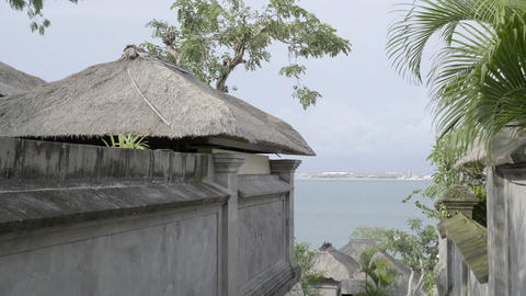 Stone tropical cottage village on the seashore. Slow motion Live Action