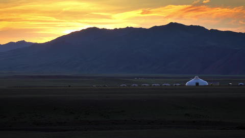Mountains and traditional yurts after sunset Live Action