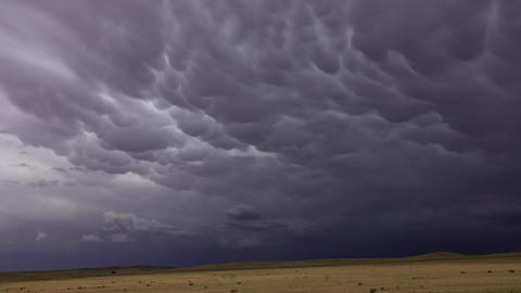 Mammatus clouds dramatic sky and steppe Live Action