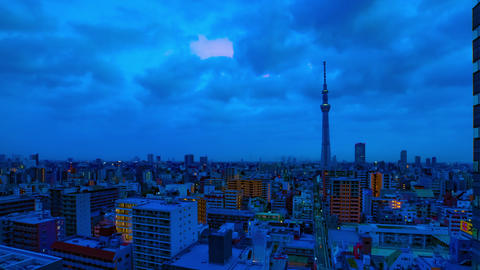 A dawn timelapse at the urban city street in Tokyo high angle wide shot zoom Live Action