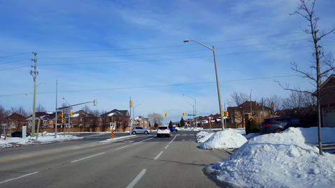 Car Waits With Patience at Red Light at City Street Intersection in Winter. Vehicle Patient on Urban Live Action