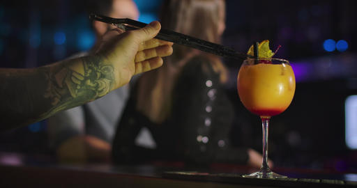 Close-up of male Caucasian hand with tattoo preparing cocktails in night club Live Action