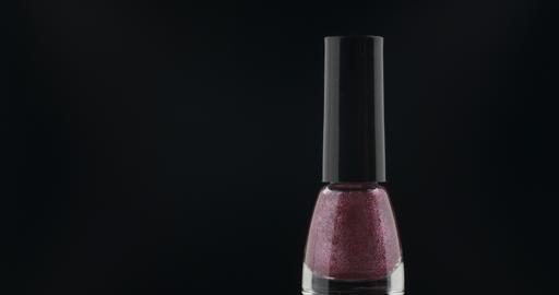 Rotation of nail polish on a black background ライブ動画