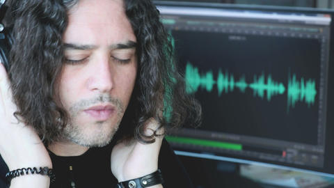 music composer man with long hair listen with headphones focusing with audio Live Action