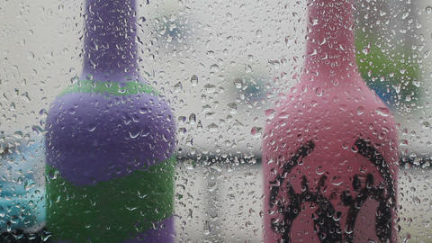 Close-up of water droplets on glass, Rain Rain, Go Away. Large rain drops strike a window pane Live Action