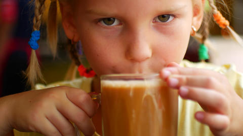 Little girl drinks a hot milk drink and burns hersel Live Action