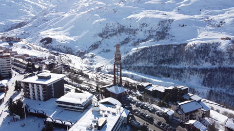 Majestic winter aerial landscape and ski resort with typical alpine wooden Live Action