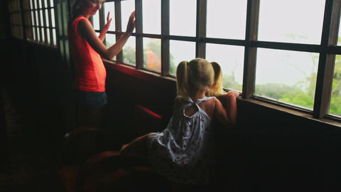 Little Blond Girl Mother Look out of Window at Foggy Landscape Footage