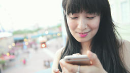 young Asian woman using smartphone, closeup portrait Live影片
