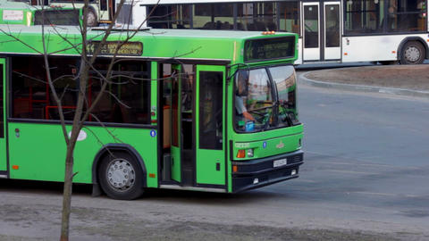 1080p Driver Enters Cabin of Green Passenger Bus Footage