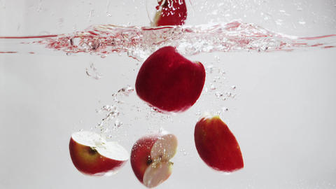 Apples Fall into Water in Slow Motion Footage