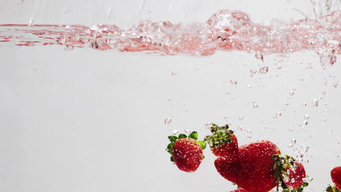 Strawberries Falling into Water in slow motion 002 Footage