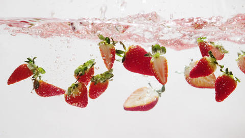 Strawberries Falling into Water in Slow Motion Footage