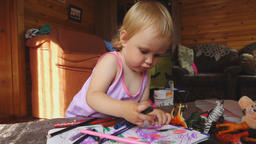 Sweet little girl draws with colored pencils Footage