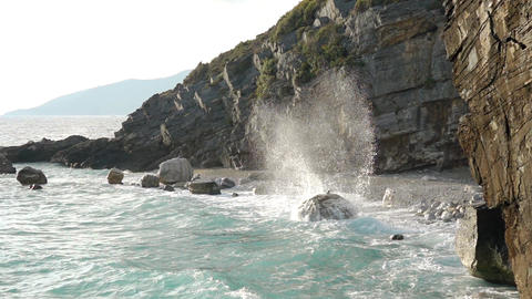 Surf on the Rocky Shore and Spray. Slow Motion Live Action