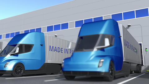 Modern semi-trailer trucks with MADE IN PAKISTAN text being loaded or unloaded Acción en vivo