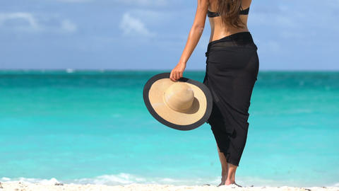 Luxury Travel Woman Holding Sunhat At Beach - Summer Travel Holidays Live Action