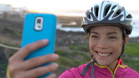 Happy Cyclist Photographing Using Smart phone - Healthy Active Lifestyle Live Action