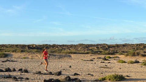 Determined Woman Running In Arid Landscape Live Action