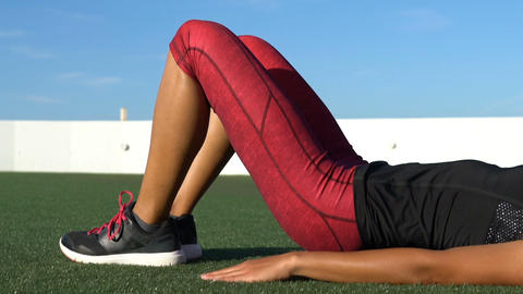 Sporty Woman Doing Spine Hip Lift Exercise - Fitness Exercise Close up Live Action