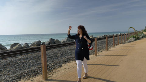 Woman happy Beautiful sunny summer Day Walking and looking far away at ocean Live Action