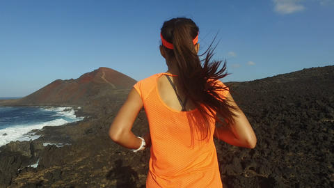 Trail Running Determined Woman On Mountain - runner exercising on rocky path Live Action