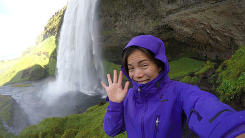 Woman Waving Hello By Majestic Waterfall Iceland - Girl Exercising In Summer Live Action