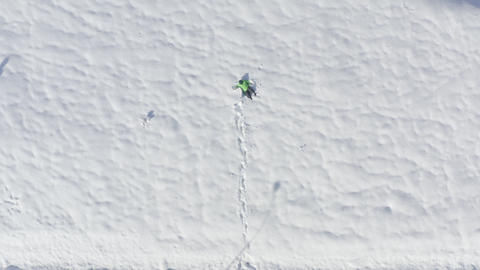 Top view man walking on winter snowdrift. Aerial view man falling on white fluffy snow at winter Live Action