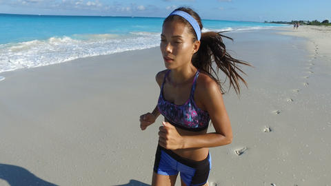 Asian Female Jogger Running On Beach In Summer - Female Runner Workout Live Action