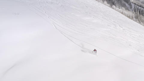 Snowboarder riding freeride on snowboard on powder fresh snowy slope on winter forest landscape. Live Action
