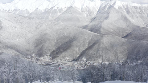 Wonderful view from above snowy city in winter mountain valley. Aerial shooting beautiful mountain Live Action