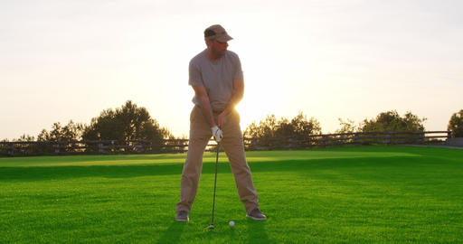 Handsome older golfer swinging golf club, golfing in paradise Live Action