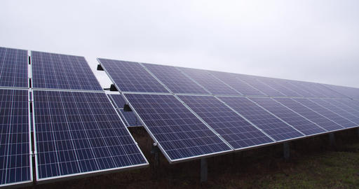 Solar power station, a row of solar panels, sustainable energy, eco friendly, 4k Live Action