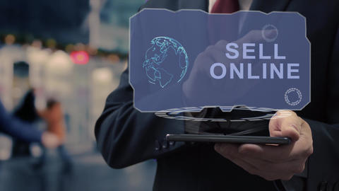 Businessman uses hologram Sell online Live Action
