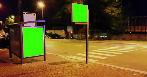 Billboard with a chroma key green screen on a traffic city night street, light night Live Action