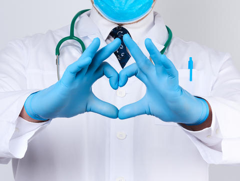 adult doctor man in a white medical coat with a stethoscope on h Fotografía