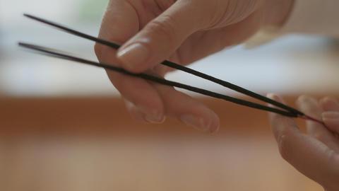 Burning aromatic sticks for meditation while doing yoga Live Action