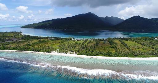Aerial view of French Polynesia Tahiti island Huahine and Motu coral reef lagoon Live Action