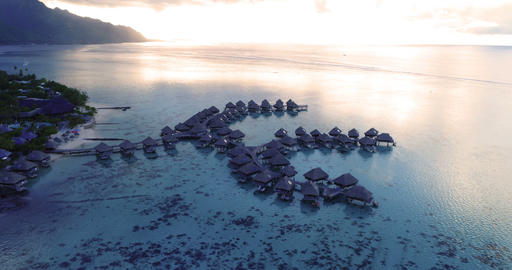 Tropical vacation paradise island with overwater bungalows in coral reef sea Live Action