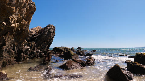 Sea wave coast to the rock and sand beach GIF