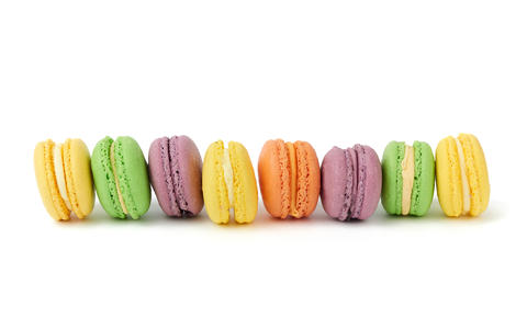 multicolored round baked macaroon cakes isolated on a white back Fotografía