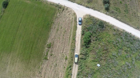 Meeting of Two Cars on a Dirt Road Footage