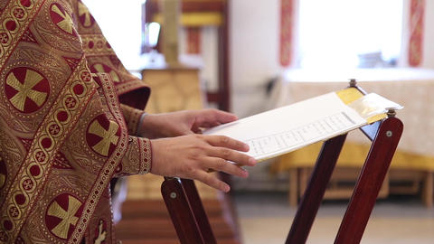 An orthodox priest in the church prays Footage
