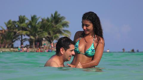 Woman Wearing Bikini With Man Floating In Water Footage