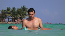 Bikini Clad Woman Floating In Ocean Footage