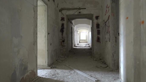 Walking in the Hallway of a Ruined Building Live Action