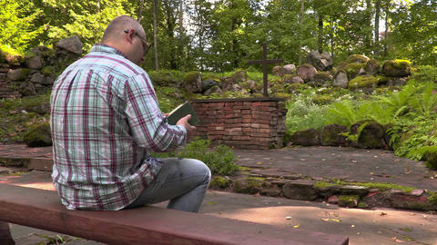 Man reading the Bible in outdoor church Footage