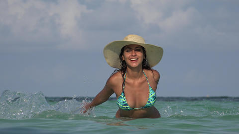 Woman Wearing Swimsuit In Ocean Live Action