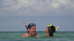 Fun Couple Swimming In Ocean On Vacation Live Action