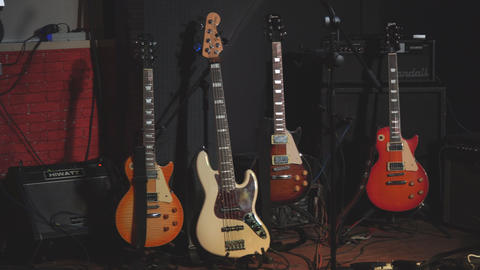 Electric guitars before the concert stand on stage on stands Live Action